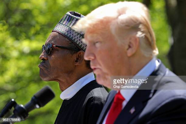 Nigerian President Muhammadu Buhari listens to US President Donald Trump during their a joint press conference in the Rose Garden of the White House...
