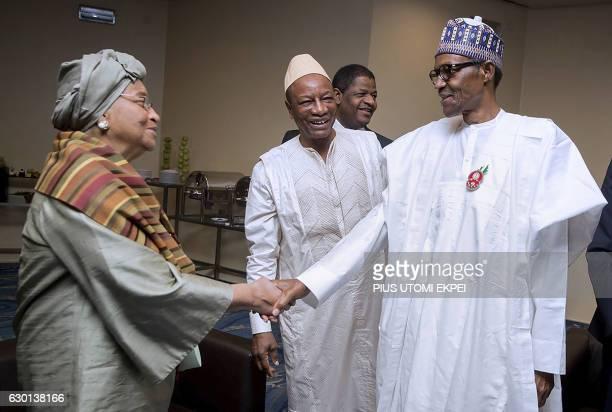 Nigerian President Muhammadu Buhari shakes hand with Liberian President and Ecowas Chairperson Ellen Johnson Sirleaf while Guinean President Alpha...