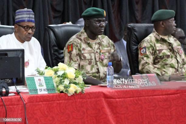 Nigerian president Muhammadu Buhari sits next to Nigeria chief of Army staff Tukur Yusuf Buratai during the opening ceremony of the military staff...