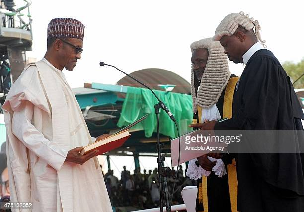 Nigerian President Muhammadu Buhari taking his oath of office before Chief Justice of Nigeria Justice Mahmud Mohammed during his inauguration in...