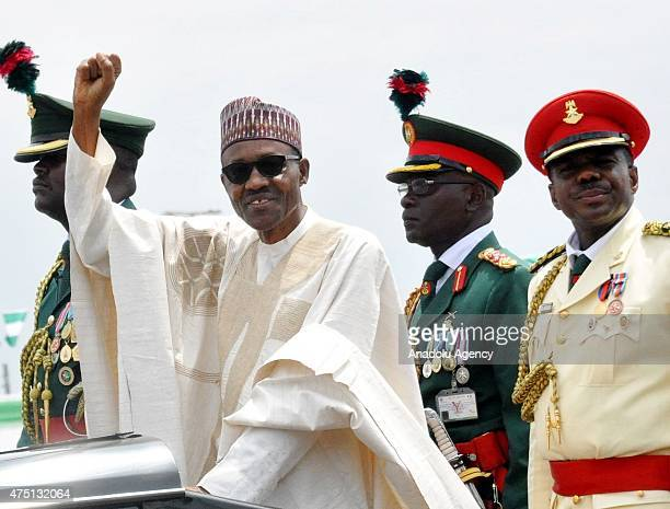 Nigerian President Muhammadu Buhari waves to supporters during his inauguration in Abuja Nigeria 29 May 2015 Muhammadu Buhari was inuagurated as...