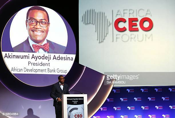 Nigerian President of the African Bank of development Akinwumi Adesina delivers a speech at the opening ceremony of the Africa CEO Forum Awards that...