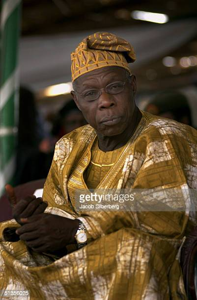 Nigerian President Olesegun Obasanjo watches the Argungu Fishing Festival on March 20 2004 in Argungu Nigeria The Argungu Fishing Festival was first...