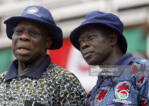 Nigerian President Olusegun Obasanjo chats with President of Nigeria Labour Congress Adams Oshiomhole 01 May 2004 during workers' rally at the Lagos...