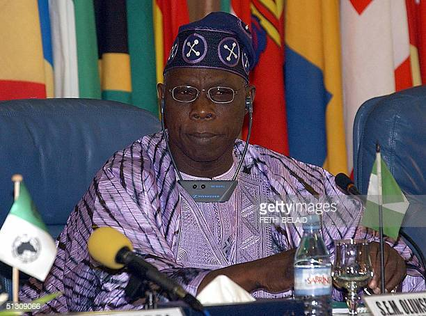 Nigerian President Olusegun Obasanjo speaks at the opening of an international symposium on African development and the fight against poverty...