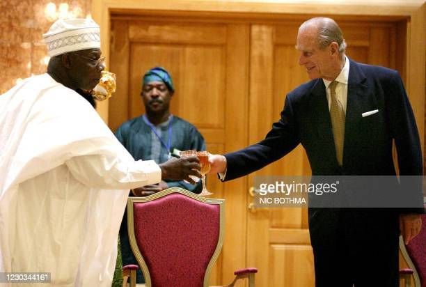 Nigerian President Olusegun Obasanjo toasts with Prince Philip, Duke of Edinburgh, during a reception in honor of Britain's Queen Elizabeth II at the...