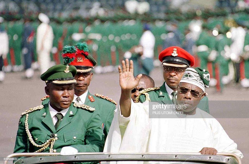 Nigerian President Olusegun Obasanjo waves to the : News Photo