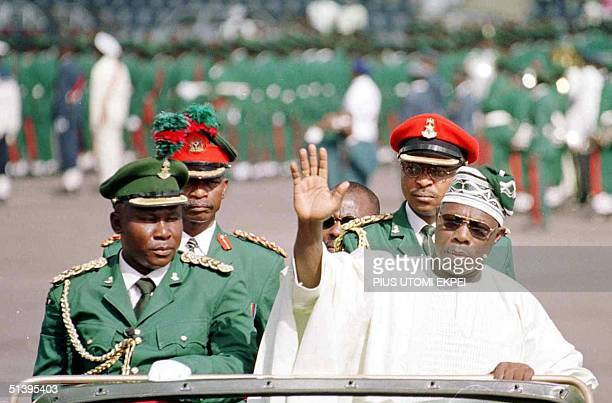 Nigerian President Olusegun Obasanjo waves to the crow at the Eagle Square in Abuja 01 October 2000 Obasanjo arrived at the 40th independence...