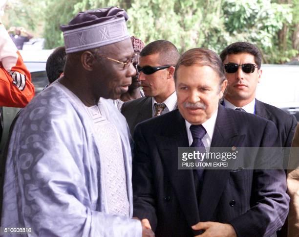 Nigerian President Olusegun Obasanjo welcomes Algerian President Abdelaziz Bouteflika at the ECOWAS building the venue of the NEPAD summit in Abuja...