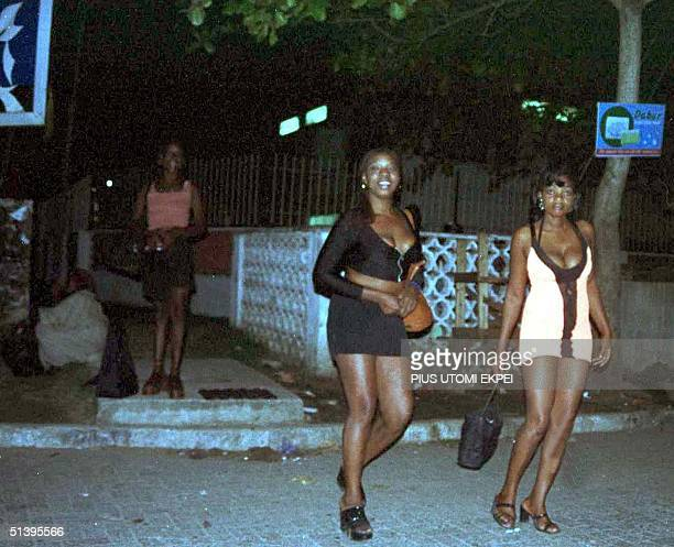 Nigerian prostitutes wait for customers 14 October 2000 in sexy wears at the Victoria Island district of Lagos All over the country large number of...