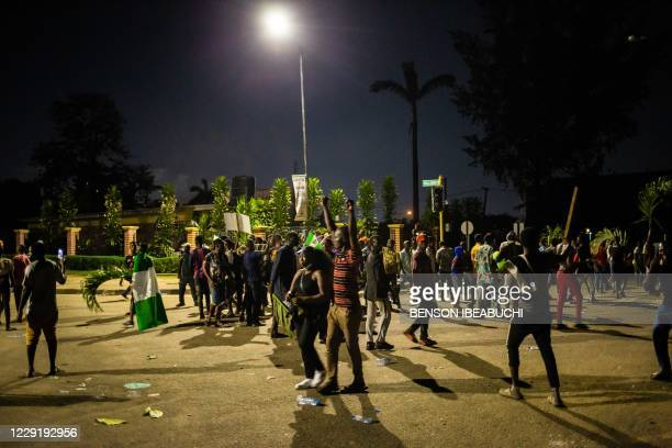 Nigerian protesters are seen in the streets of Alausa Ikeja on October 20, 2020 after the authorities declared an open-ended lockdown in Lagos in the...
