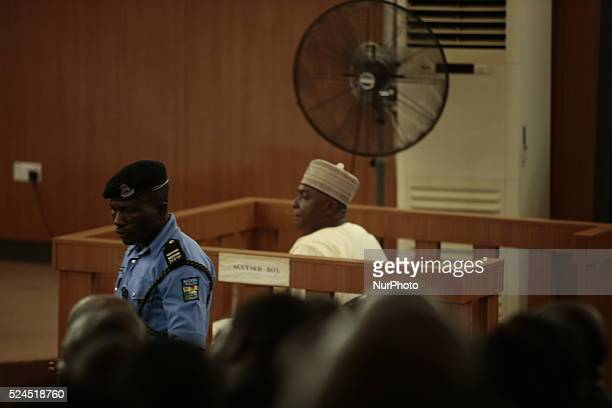 Nigerian Senate President Bukola Saraki sits in the accused box as he looks at a policeman during a hearing on corruption charges against him at the...
