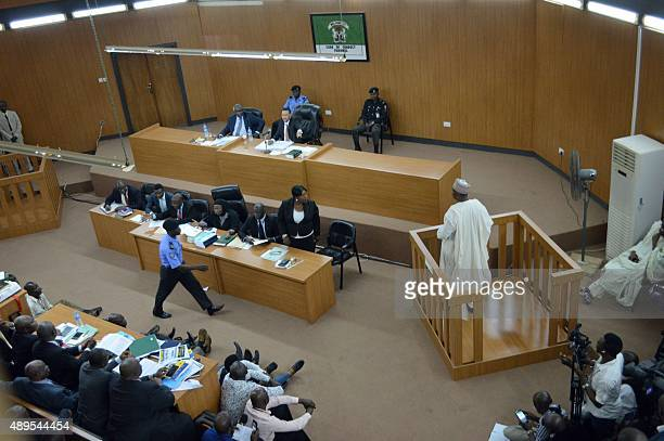 Nigerian Senate President Bukola Saraki stands in the accused box facing the judges during a hearing of corruption charges against him at the Code of...