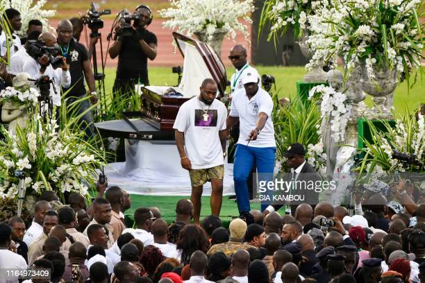Nigerian singer Davido leaves after paying his respects to late Ivorian singer DJ Arafat during his funeral ceremony at the Felix HouphouetBoigny...
