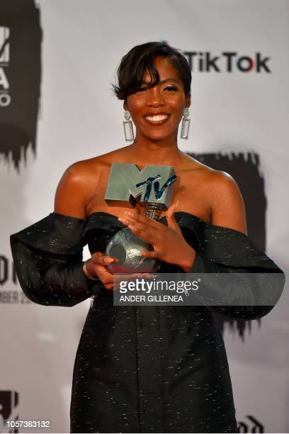 Nigerian singer Tiwa Savage poses backstage with her Best African Act award during the MTV Europe Music Awards at the Bizkaia Arena in the northern...