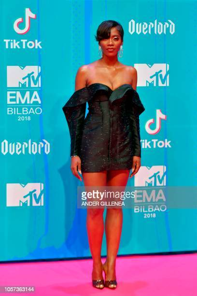 Nigerian singer Tiwa Savage poses on the red carpet ahead of the MTV Europe Music Awards at the Bizkaia Arena in the northern Spanish city of Bilbao...
