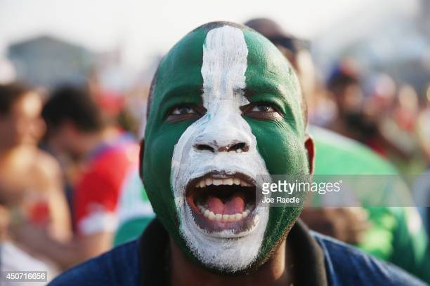 Nigerian soccer fan looks on as his team plays against Iran as he watches on a giant screen at the FIFA World Cup Fan Fest on Copacabana beach on...
