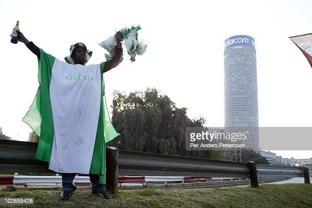 Nigerian soccer fan stands with a green painted live chicken before a game between Nigeria and Argentina on June 12 2010 outside Ellis Park stadium...