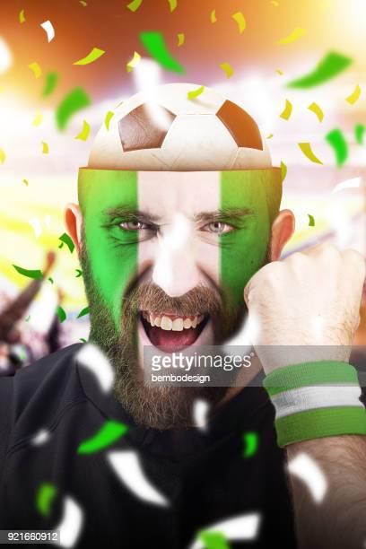 Nigerian soccer fan with football inside the head
