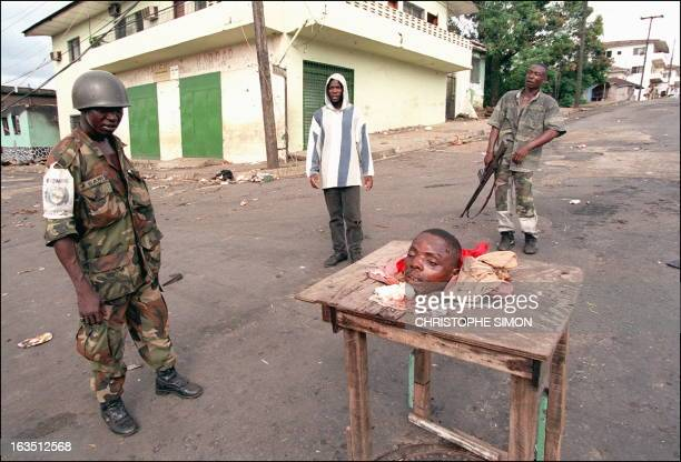 Nigerian soldier from the Nigerianled West Afican peacekeeping force ECOMOG looks 07 May 1996 at the checkpoint on Benson street in downtown Monrovia...