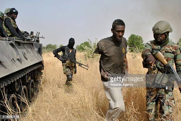 Nigerian soldiers capture a terrorist after an operation against Boko Haram terrorists at a terrorist camp in Borno, Nigeria on March 29, 2016.