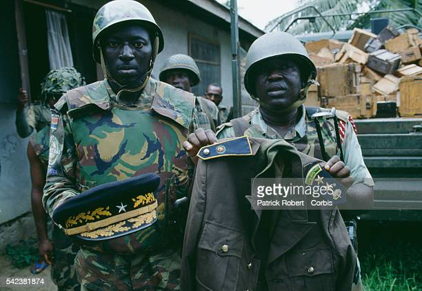 Nigerian soldiers from ECOMOG hold up a military uniform as they patrol the Caldwell front during the Liberian Civil War In 1989 Charles Taylor...