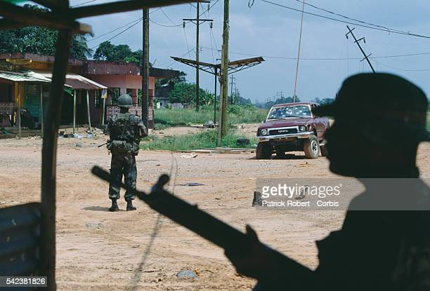 Nigerian soldiers from ECOMOG patrol the Caldwell front during the Liberian Civil War. In 1989, Charles Taylor, leader of the NPFL , launched a...