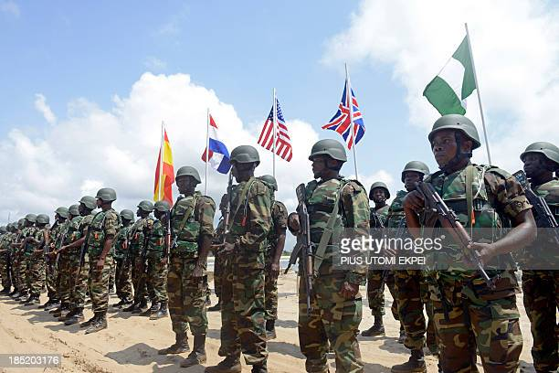 Nigerian soldiers march before flags of participating countries during a joint military exercise between Nigerian armed forces United States Britain...