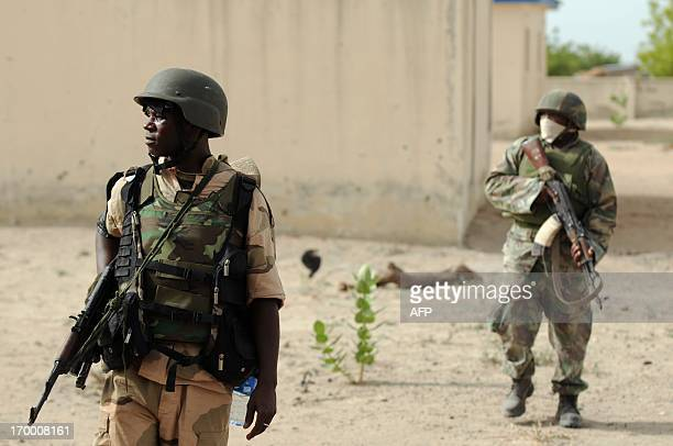 Nigerian soldiers patrol in the north of Borno state close to a Islamist extremist group Boko Haram former camp on June 5 2013 near Maiduguri...