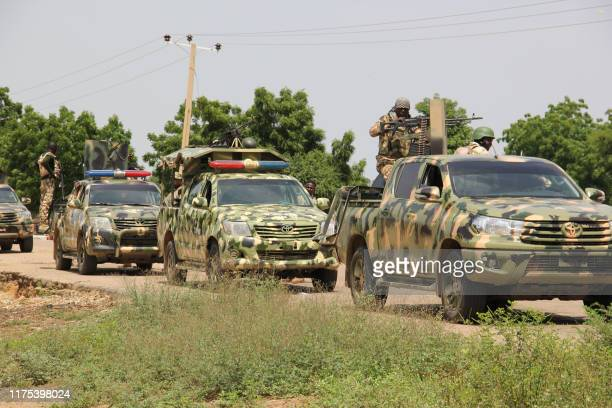 Nigerian soldiers patrol on October 12 after gunmen suspected of belonging to the Islamic State West Africa Province group raided the village of...