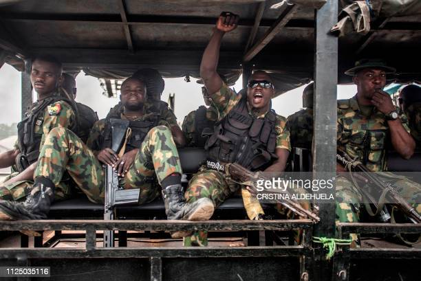 TOPSHOT Nigerian soldiers ride in a truck during a patrol of Aba a city in southern eastern Nigeria and a stronghold for probiafran separatists...