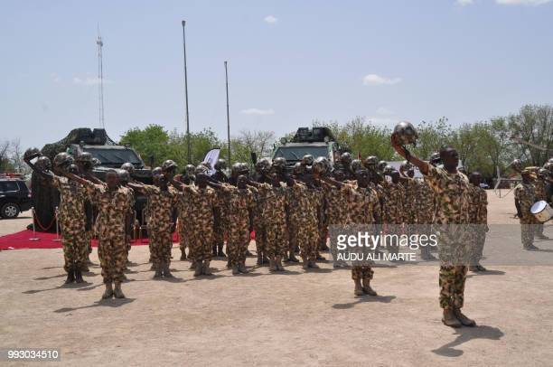 Nigerian soldiers salute during a visit by President in Maiduguri on July 6 2018 during the celebrations for Nigeria Army day