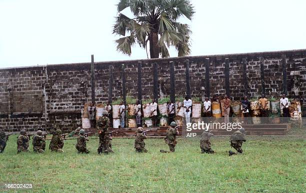 Nigerian soldiers shoot 43 prisoners who were sentenced to death during their mass execution by firingsquad before a crowd of 1000 spectators 22 July...
