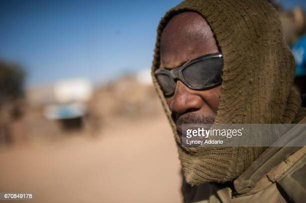 Nigerian soldiers with UNAMID the United Nations African Mission in Darfur patrol through the villages of Silea and Sirba which were recently bombed...