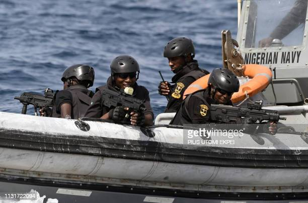 Nigerian special forces sail to intercept pirates during a joint exercise between Nigerian and Moroccan naval personels as part of Obangame Express,...