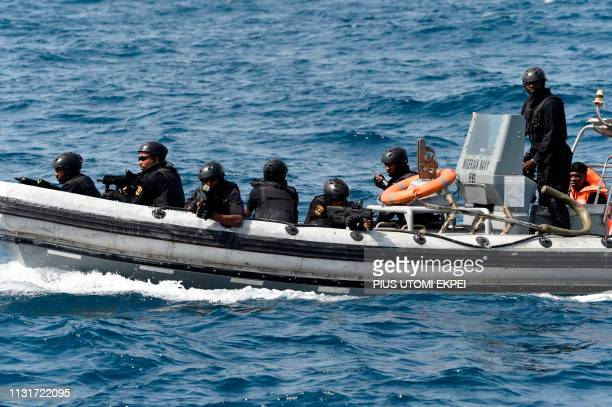 Nigerian special forces sail to intercept pirates during a joint exercise between Nigerian and Moroccan naval personels as part of Obangame Express a...