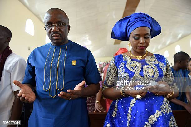Nigerian sponsor Obinna Onuoha and his wife Nkeiru pray at the St Aloysius Catholic Church before the unveiling ceremony of the ninemetre tall statue...