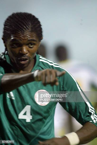 Nigerian striker Kanu Nwankwo points to the Gabonese net after scoring the second goal for his national team 26 March 2005 in an African zone World...
