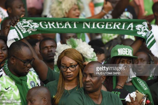 Nigerian supporters hold banners during an international friendly football match between Nigeria and DR Congo at the Adokiye Amiesimaka Stadium in...