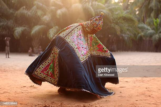 Nigerian 'Voodoo Spirit' dances during a ceremony on January 10 2012 in Ouidah Benin Each spirit represents the reincarnation of a dead member of the...