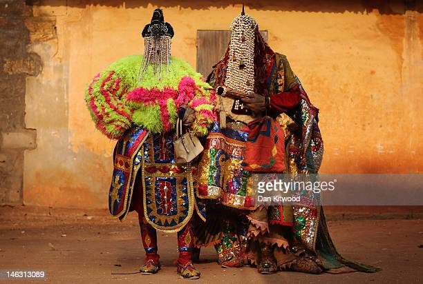 Nigerian 'Voodoo Spirits' walk the streets on January 10 2012 in Ouidah Benin Each spirit represents the reincarnation of a dead member of the...