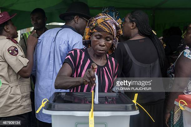 A Nigerian voter casts her ballot in Otuoke on March 28 2015 Problems with new technology forced a 24hour extension to the presidential election in...