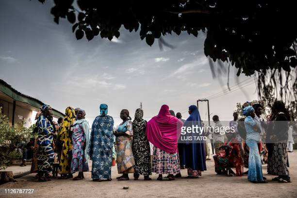 TOPSHOT Nigerian voters queue to cast their votes at Shagari Health Unit polling station in Yola Adamawa State Nigeria on February 23 the day of the...