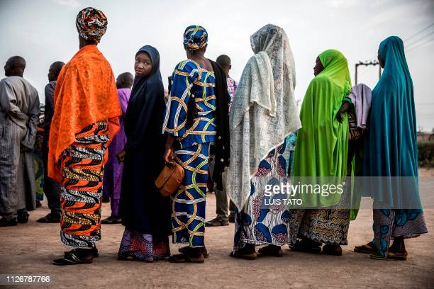 Nigerian voters queue to cast their votes at Shagari Health Unit polling station in Yola Adamawa State Nigeria on February 23 the day of the general...
