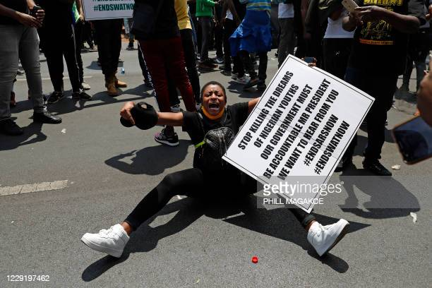 Nigerian woman based in South Africa screams while protesting outside their embassy in Pretoria on October 21, 2020 in solidarity with Nigerian youth...
