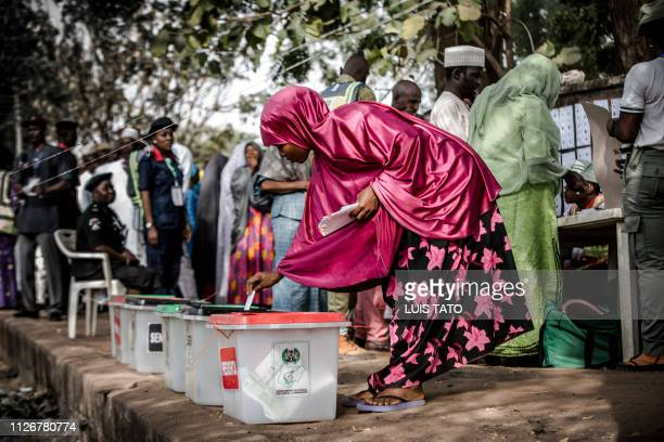 Nigerian woman casts her vote for a candidate in the presidential election at Agiya polling station a few hours before polls opened in Yola Adamawa...