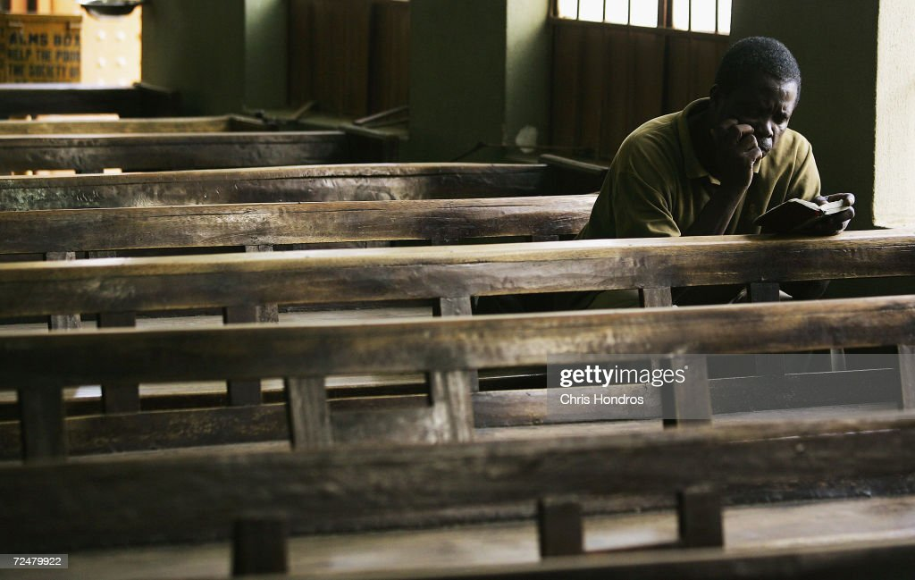 A Nigerian worshipper reads through his Bible after other parish