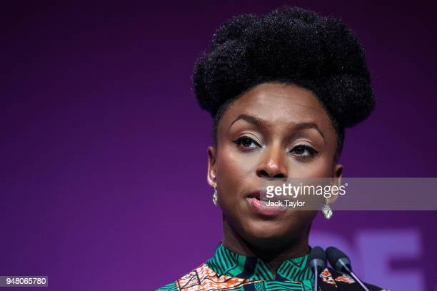 Nigerian writer Chimamanda Ngozi Adichie makes a speech at the Malaria Summit at 8 Northumberland Avenue on April 18 2018 in London England The...