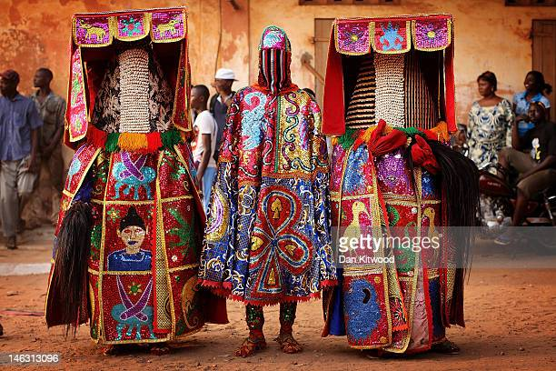 Nigerian Yaruba Voodoo Spirits perform during a Voodoo ceremony on January 11 2012 in Ouidah Benin Each spirit represents the reincarnation of a dead...