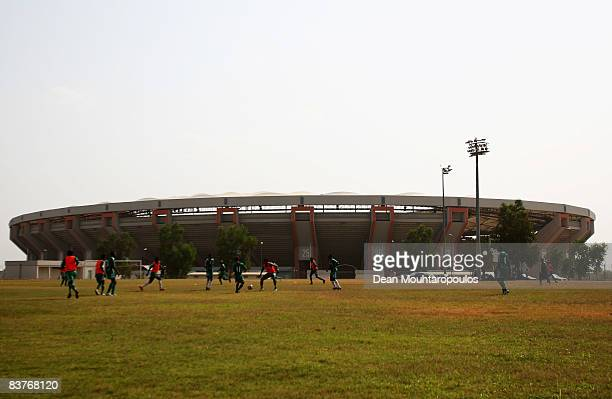 Nigerian youth footballers play next to the Abuja National Stadium on November 20 2008 in Abuja Nigeria